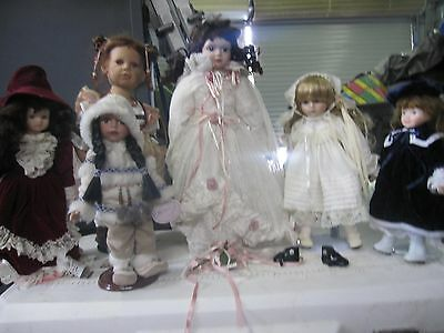 Collection of porcelain dolls with accessories