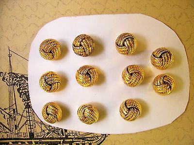 11 vintage gilded 'knot' buttons 17 mm. diameter