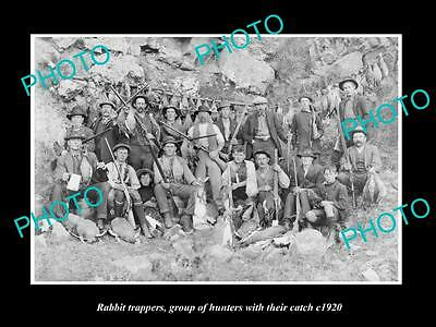 OLD LARGE HISTORIC PHOTO OF RABBIT TRAPPERS, HUNTING TEAM WITH THEIR CATCH c1920