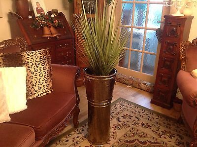 tall brass coloured plant holder with lions head handles