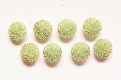 A set of 8 vintage pistachio opaque glass buttons with gilded detailing 15 mm.