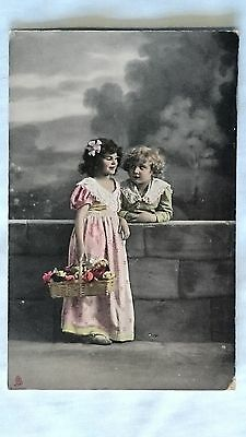 Postcard - Vintage Edwardian girl with flowers and boy, colourised, Tucks