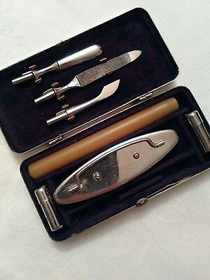 Antique gentlemans manicure set in fitted white metal box with blank cartouch