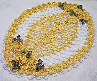 yellow and white ^crocheted oval  roses doily  by Aeshagirl