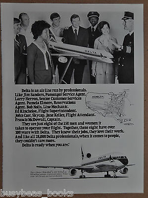 1976 Delta Air Lines advertisement, crew members around L-1011 TriStar model