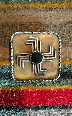 native american whirling log belt buckle silver and brass