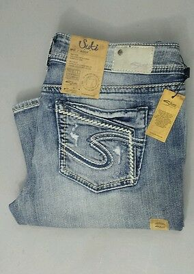 Silver Jeans Suki Mid Rise Boot Distressed Embellished Stitching Flap 33/33 NWT