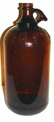 "Vintage 64 Ounce Brown Javex Bottle With Handle - 11"" Tall - Embossed ""javex"""