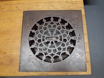 Antique cast iron floor vent heater grate round ornate design