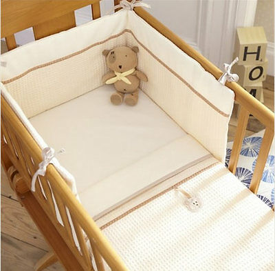 Brand new in pack Izziwotnot cream gift two piece crib set quilt and bumper