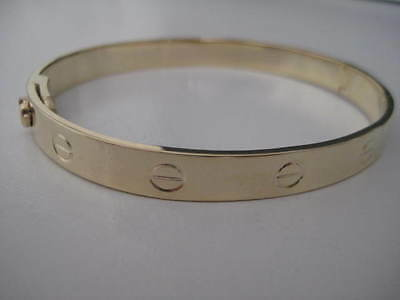 9ct yellow gold SOLID screw oval ladies bangle with screwdriver