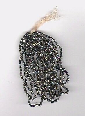 Vintage/antique black glass seed beads with green iris luster--18/0.