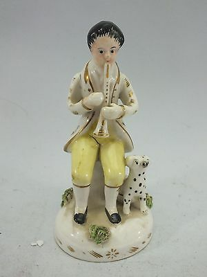 A STAFFORDSHIRE PORCELAIN FIGURE OF A MAN PLAYING THE FLUTE AND WITH DOG19thC