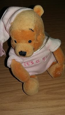 Winne the pooh, small soft toy, wearing its a girl t shirt