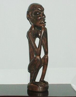 CARVED AFRICAN WOOD SCULPTURE, SITTING MAN, DISPLAY  (z)