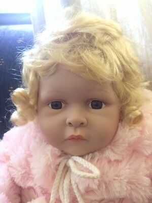 Homeart Collectible Vinyl Baby Doll Emily sitting Pink Fur