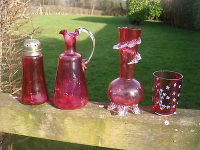 Four Items Of Victorian Cranberry Glass For Display Sifter Vase Ewer Beaker