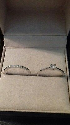 2 9ct white gold rings ( 1 diamond solitaire & the other a diamond half hoop )