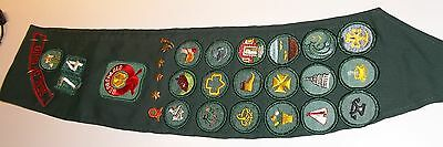 Older Girl Scout Sash with 18 Merit Badges, 5 pins and 5 opther patches