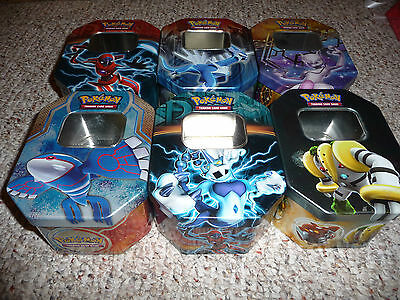 pokemon 6 collectiable empty tin,like new condition,inc. rare mewtwo and others