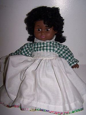 """Remco 1991 Doll says """"Hispanic"""" on neck  with dress 16 in. dark skinned no shoes"""