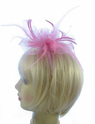 pink long feather fascinator on a satin matching headband weddings, races Prom