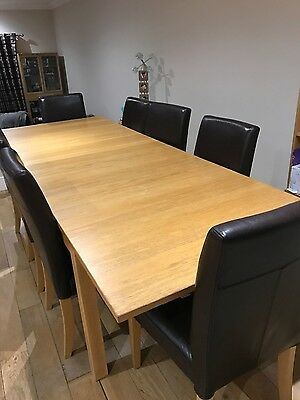 Dining table with 8 matching chairs