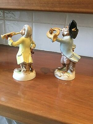 Two porcelain hand-painted monkey band figurines