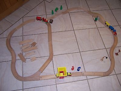 Wooden train track and 2 trains