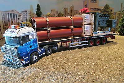 1.50 scale handcrafted truck load of pipes and a generator for a flatbed trailer