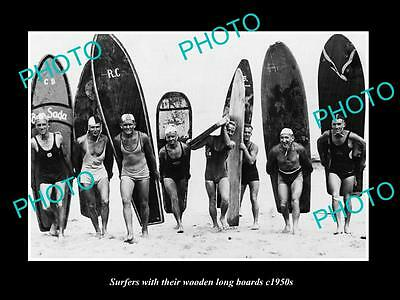 OLD LARGE HISTORIC PHOTO OF MEN WITH THEIR WOODEN SURF LONGBOARD, c1950s