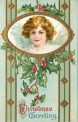 Clapsaddle Christmas Angel Looks Out Oval~Holly Berries~Art Nouveau~Gold~Emboss