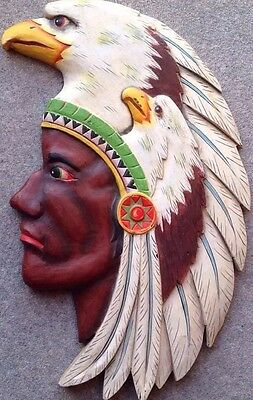 Hand Carved and Painted Plaque of a Native American with anEagle Head Dress.