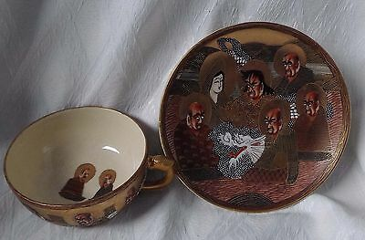 ANTIQUE SATSUMA CUP AND SAUCER..IMMORTALS WITH DRAGON IN MORIAGE RELIEF..c.1880