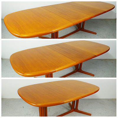 mid century long Danish modern teak expanding dining table with 2 hide leafs