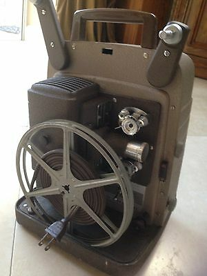 Vintage Bell and Howell 253 AX 8mm Film Movie Projector With Projector Screen.