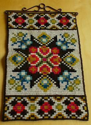 Swedish wool-embroidered sampler, traditional star motif with flowers, hanger