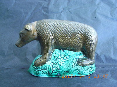 Staffordshire Creamware Pottery Figure of a Collared Bear on a Floral Mound
