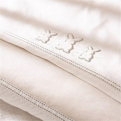 New Izziwotnot premium gift cot bed sheet one flat one fitted cream  two pack