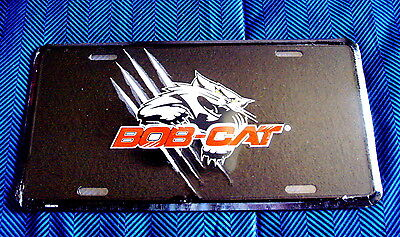 BOB-CAT - EMBOSSED METAL LICENSE PLATE - Black background/White CAt- NEW