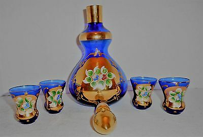 Blue glass with gold overlay decanter with glasses