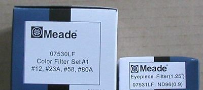 5 Meade telescope eyepiece filters 4 colored and one moon filter