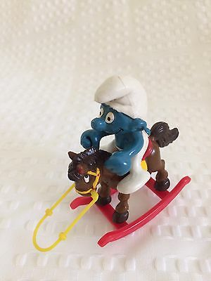 Vintage Smurf on Rocking Horse made by Schleich Peyo in Hong Kong + Cowboy