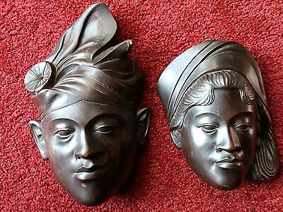Asian face plaques hand carved