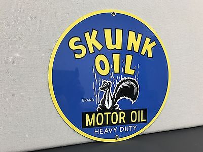 Skunk motor oil  garage advertising sign round thick oil