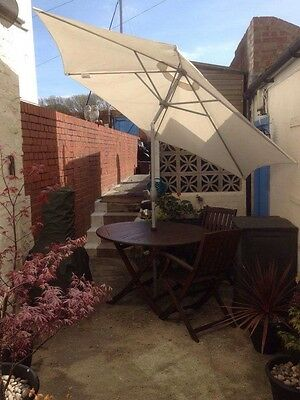 patio table and chairs with Parasol