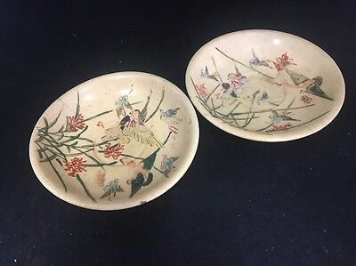 Pair of old antique unknown oriental saucers hand painted with birds unusual