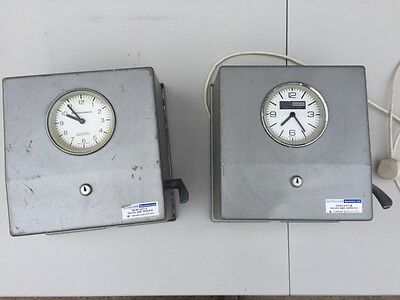 pair vintage industrial clocking in machines