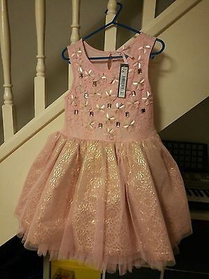 a beautiful pale pink girls Next dress size 6 years new with tag wedding party