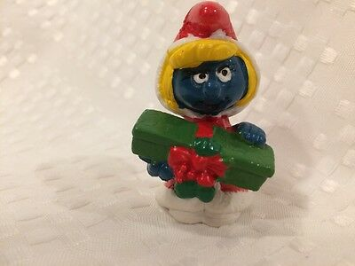 Vintage Holiday Christmas Smurfette in red holding package Schleich Peyo 1981.